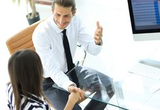 Handshake of a Manager and a customer. At the Desk Royalty Free Stock Photos