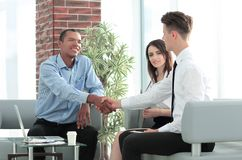 Handshake Manager and customer in a modern office. The concept of cooperation stock images