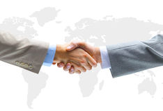 Handshake with map Stock Image