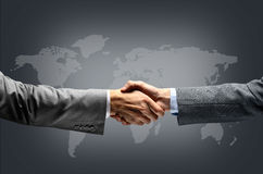Handshake with map Stock Images