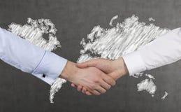 Handshake and  map Stock Photography