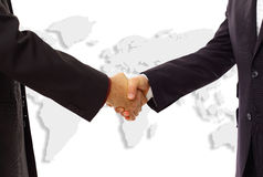 Handshake with map of the world Royalty Free Stock Photography