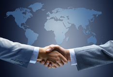 Handshake with map of the world Stock Image