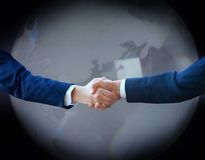 Handshake with map Royalty Free Stock Photography