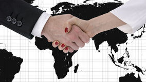 Handshake with map of the world in background Royalty Free Stock Photos