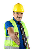 Handshake mature construction engineer. Portrait of mature construction engineer with protective waistcoat and hard hat give handshake isolated on white Royalty Free Stock Photo