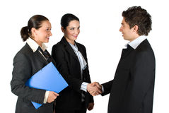 Handshake and meeting business people. Three business people successful give handshake at meeting ,one of the woman holding the blue folder with contract,more royalty free stock image
