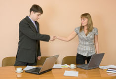 Handshake men and young women Royalty Free Stock Image