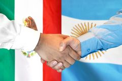 Handshake on Mexico and Argentina flag background. Business handshake on the background of two flags. Men handshake on the background of the Mexico and Argentina royalty free stock photography