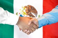 Handshake on Mexico flag background. Business handshake on Mexico flag background. Men shaking hands and Mexico flag on background. Support concept stock image