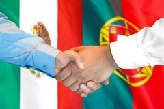 Handshake on Mexico and flag background. Business handshake on the background of two flags. Men handshake on the background of the Mexico and flag. Support stock image
