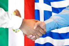 Handshake on Mexico and Greece flag background. Business handshake on the background of two flags. Men handshake on the background of the Mexico and Greece flag royalty free stock photo