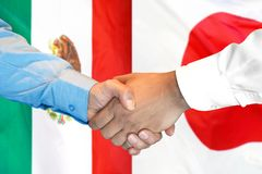 Handshake on Mexico and Japan flag background. Business handshake on the background of two flags. Men handshake on the background of the Mexico and Japan flag royalty free stock image