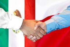 Handshake on Mexico and Poland flag background. Business handshake on the background of two flags. Men handshake on the background of the Mexico and Poland flag royalty free stock photo