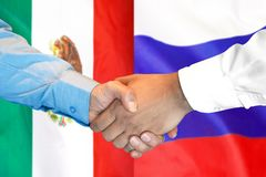 Handshake on Mexico and Russia flag background. Business handshake on the background of two flags. Men handshake on the background of the Mexico and Russia flag royalty free stock image