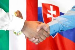 Handshake on Mexico and Slovakia flag background. Business handshake on the background of two flags. Men handshake on the background of the Mexico and Slovakia stock photo