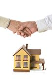 Handshake at miniature house Stock Images
