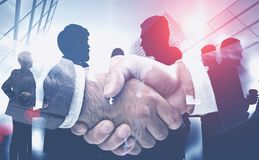 Handshake in modern city, business team royalty free stock image