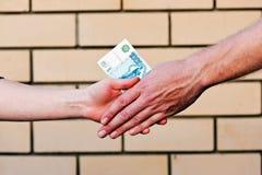 Handshake with money Stock Photos