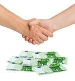Handshake and money euro. Isolated on white background Stock Photo