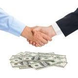 Handshake and money Stock Images