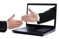 Handshake through monitor Royalty Free Stock Image