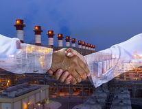 Handshake multi exposure with a power plant background royalty free stock photos