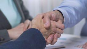 Handshake after negotiations, positive lending decision, property investor