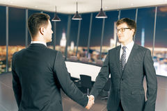 Handshake at night Royalty Free Stock Photography