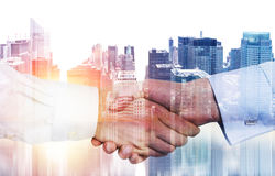 Handshake on NY background multiexposure royalty free stock photography