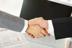 Handshake in the office Royalty Free Stock Photos