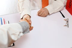 Handshake at office desk Royalty Free Stock Image