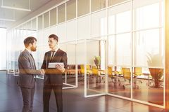 Handshake in office with meeting room stock photography