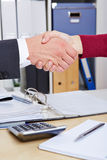 Handshake in office after Stock Images