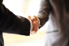 Handshake in office. royalty free stock image