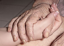 Handshake of old and young hands, fragment Stock Photography