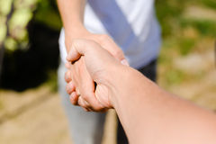 Handshake on outdoors blurred abstract nature background, image closeup Royalty Free Stock Photos
