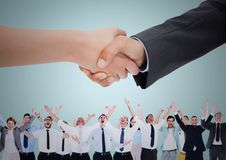 Handshake over business people with blue background Stock Photo