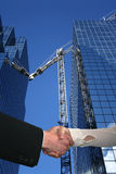 Handshake over construction site Stock Images