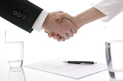 Handshake over a contract Stock Photos