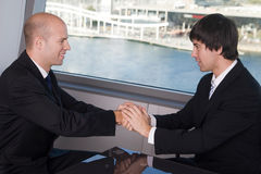 Handshake over a deal Stock Image
