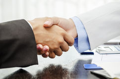 Handshake over document Stock Images