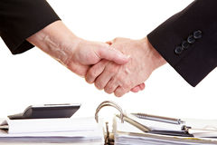 Handshake over files Stock Photo