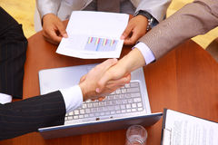 Handshake over paper Stock Photo