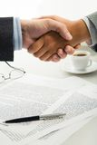Handshake over workplace Royalty Free Stock Images