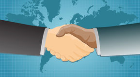 Handshake over a world map background Royalty Free Stock Image