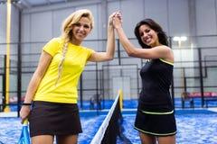 Handshake of paddle tennis players. Royalty Free Stock Photos
