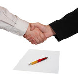 Handshake, paper and pen Royalty Free Stock Image