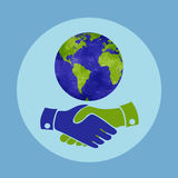 Handshake for the peace in the world. Planet and handshake. Stock Photo
