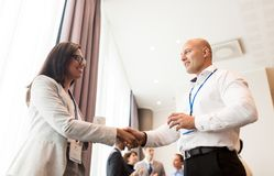 Handshake of people at business conference Stock Images
